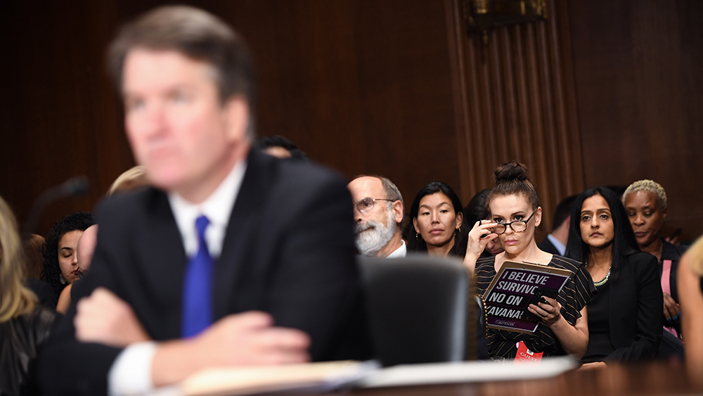 Actress Alyssa Milano (R) listens to Supreme Court nominee Brett Kavanaugh as he testifies before the US Senate Judiciary Committee on Capitol Hill Senate Judiciary Committee Brett Kavanaugh nomination hearing, Washington DC, USA - 27 Sep 2018
