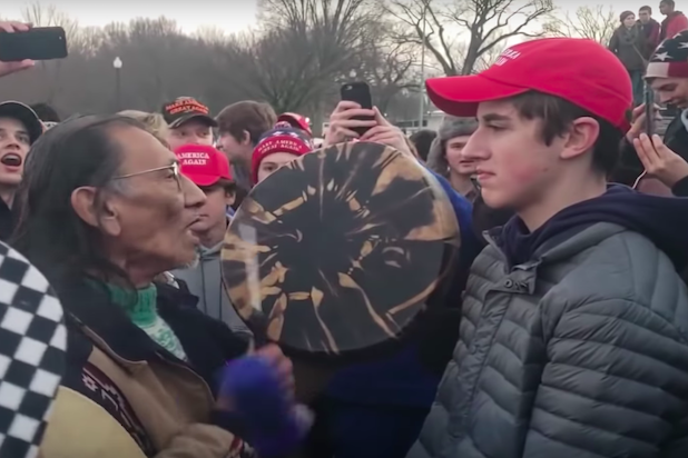 Boy wearing red MAGA hat